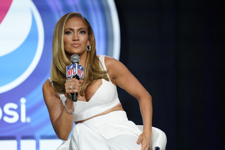 FILE - In this Jan. 30, 2020 file photo, NFL Super Bowl 54 football game halftime performer Jennifer Lopez answers questions at a news conference in Miami. Lopez will give a musical performance on the West Front of the U.S. Capitol when Biden is sworn in as the nation's 46th president next Wednesday. (AP Photo/David J. Phillip)
