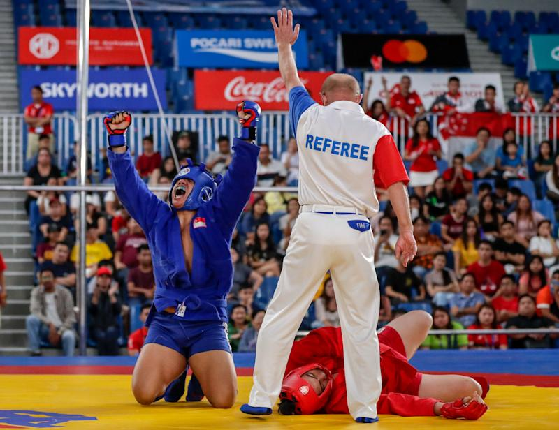 Singapore sambo athlete Nazri Sutari roars in delight after beating Indonesia's Jason Sim in the men's combat U-82kg final. (PHOTO: Sport Singapore)
