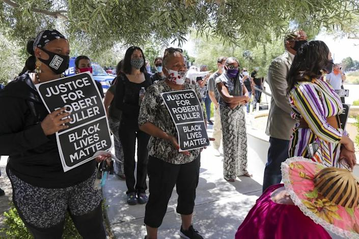 LANCASTER, CA - JUNE 18: A rally calling for justice and transparency in the deaths of Robert Fuller and Michael L. Thomas takes place in Lancaster in front of Supervisor Kathryn Barger's office on Thursday, June 18, 2020 in Lancaster, CA. (Irfan Khan / Los Angeles Times)