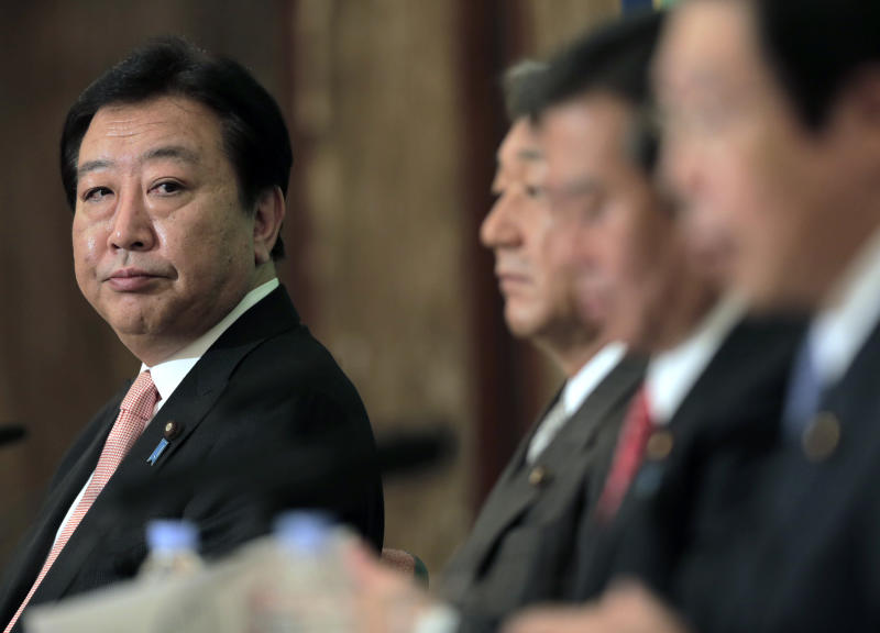 Japanese Prime Minister Yoshihiko Noda glances at Democratic Party presidential candidates during a debate at the Japan National Press Club in Tokyo Wednesday, Sept. 12, 2012. (AP Photo/Itsuo Inouye)