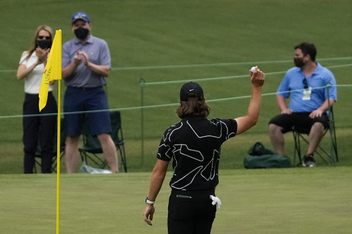 Tommy Fleetwood, of England, holds up his ball after a hole-in-one on the16th hole during the first round of the Masters golf tournament on Thursday, April 8, 2021, in Augusta, Ga. (AP Photo/Gregory Bull)