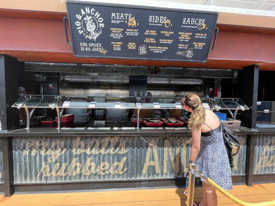 A passenger looks at her options at Guy's Pig & Anchor Bar-B-Que Smokehouse.