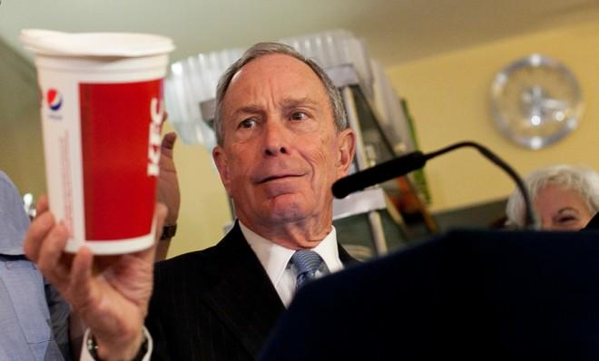 Mayor Michael Bloomberg holds a large cup during a press conference the day after a New York judge blocked the mayor's ban on oversized surgary drinks.