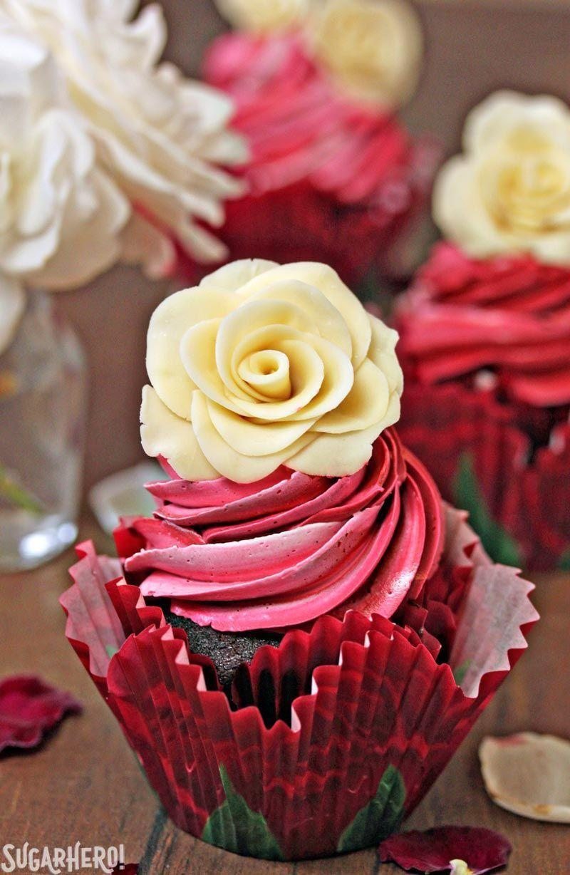 """<p>The delicate roses on top of these cupcakes are actually made of white chocolate! </p><p><strong>Get the recipe at <a href=""""https://www.sugarhero.com/chocolate-rose-cupcakes/"""" rel=""""nofollow noopener"""" target=""""_blank"""" data-ylk=""""slk:SugarHero!"""" class=""""link rapid-noclick-resp"""">SugarHero!</a></strong></p><p><strong><a class=""""link rapid-noclick-resp"""" href=""""https://go.redirectingat.com?id=74968X1596630&url=https%3A%2F%2Fwww.walmart.com%2Fsearch%2F%3Fquery%3Dpastry%2Bbag&sref=https%3A%2F%2Fwww.thepioneerwoman.com%2Ffood-cooking%2Fmeals-menus%2Fg35139389%2Fvalentines-day-cupcake-ideas%2F"""" rel=""""nofollow noopener"""" target=""""_blank"""" data-ylk=""""slk:SHOP PASTRY BAGS"""">SHOP PASTRY BAGS</a><br></strong></p>"""