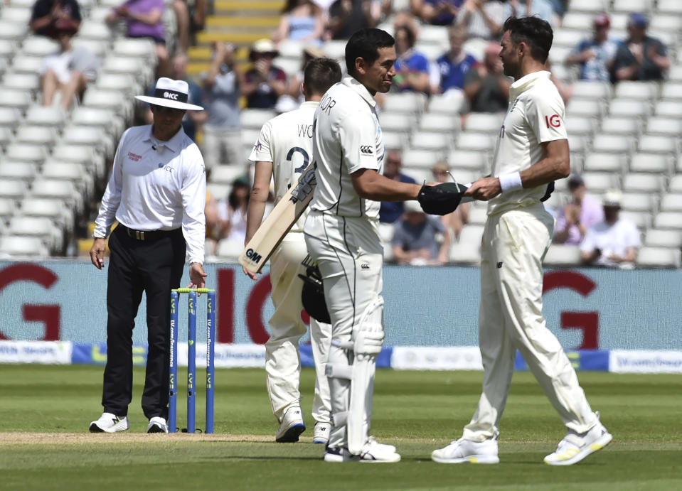 New Zealand's Ross Taylor, center, shakes hands with England's James Anderson, right, after their win on the fourth day of the second cricket test match between England and New Zealand at Edgbaston in Birmingham, England, Sunday, June 13, 2021. (AP Photo/Rui Vieira)