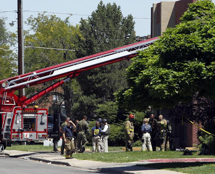 "Firefighters and police gather after an explosion could be heard outside the apartment of James Holmes in Aurora, Colo., Saturday, July 21, 2012. Federal authorities detonated one small explosive and disarmed another inside Holmes' apartment, but several other explosive devices remained, said Aurora police Sgt. Cassidee Carlson. Twelve people were killed and dozens were injured in a shooting attack early Friday at a packed movie theater during a showing of the Batman movie, ""The Dark Knight Rises."" Police have identified Holmes, 24, as the suspected shooter. (AP Photo/Ed Andrieski)"