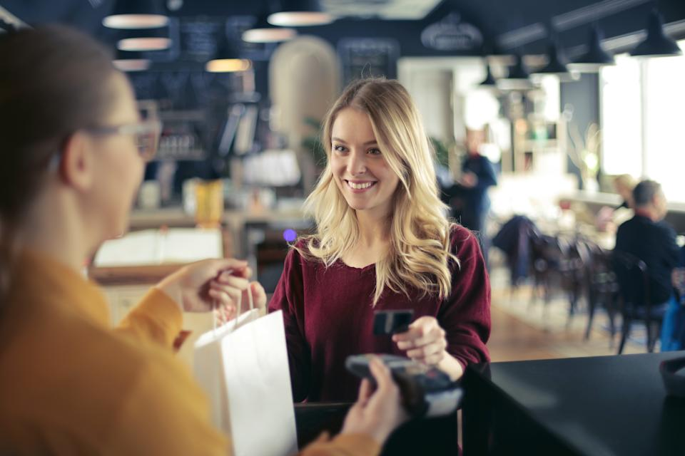Young woman is buying something