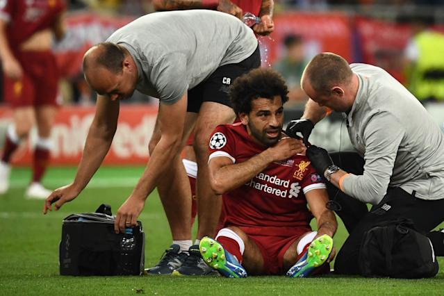 "<a class=""link rapid-noclick-resp"" href=""/soccer/players/380927/"" data-ylk=""slk:Mohamed Salah"">Mohamed Salah</a> left the Champions League final between <a class=""link rapid-noclick-resp"" href=""/soccer/teams/liverpool/"" data-ylk=""slk:Liverpool"">Liverpool</a> and Real Madrid with a shoulder injury. (Getty)"