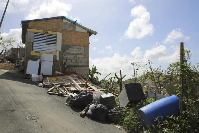 Debris gathers on the streets in Canóvanas, Puerto Rico on Oct. 14, 2017. (Carolina Moreno/HuffPost)