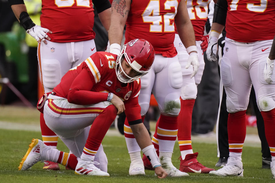 Kansas City Chiefs quarterback Patrick Mahomes kneels on the field after getting injured during the second half against the Browns. (AP Photo/Charlie Riedel)