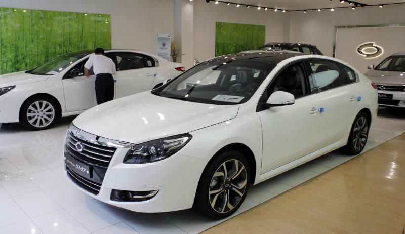 An employee of Renault Samsung Motors check a car at its showroom in Seoul, South Korea, Friday, July 20, 2012. French-Japanese auto alliance of Renault and Nissan is investing $160 million in its South Korean Renault Samsung Motors to produce Nissan-branded vehicles mostly destined for the United States, taking advantage of the South Korea-U.S. free trade agreement and a more favorable exchange rate.(AP Photo/Lee Jin-man)