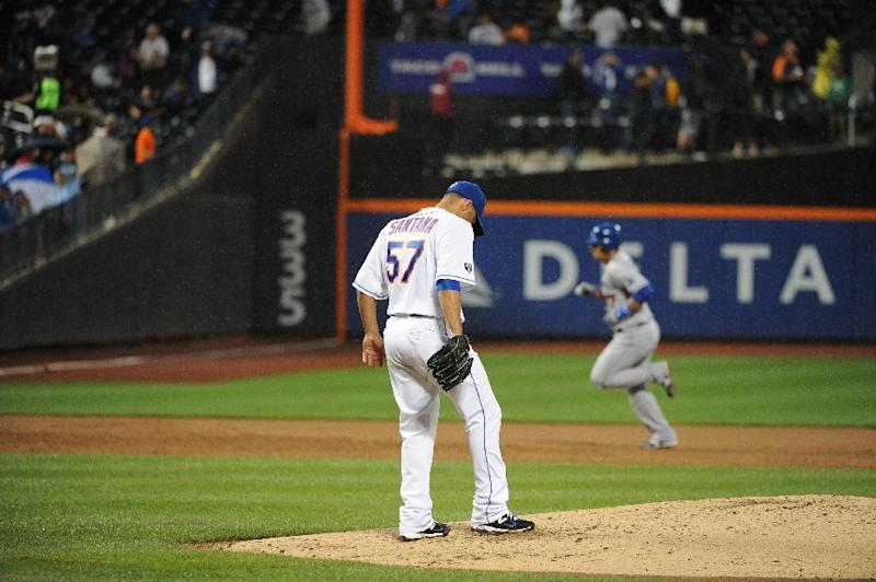 New York Mets starting pitcher Johan Santana (57) reacts on the mound as Los Angeles Dodgers' Luis Cruz rounds the bases after hitting a two-run home run in the third inning of a baseball game on Friday, July 20, 2012, at Citi Field in New York. (AP Photo/Kathy Kmonicek)