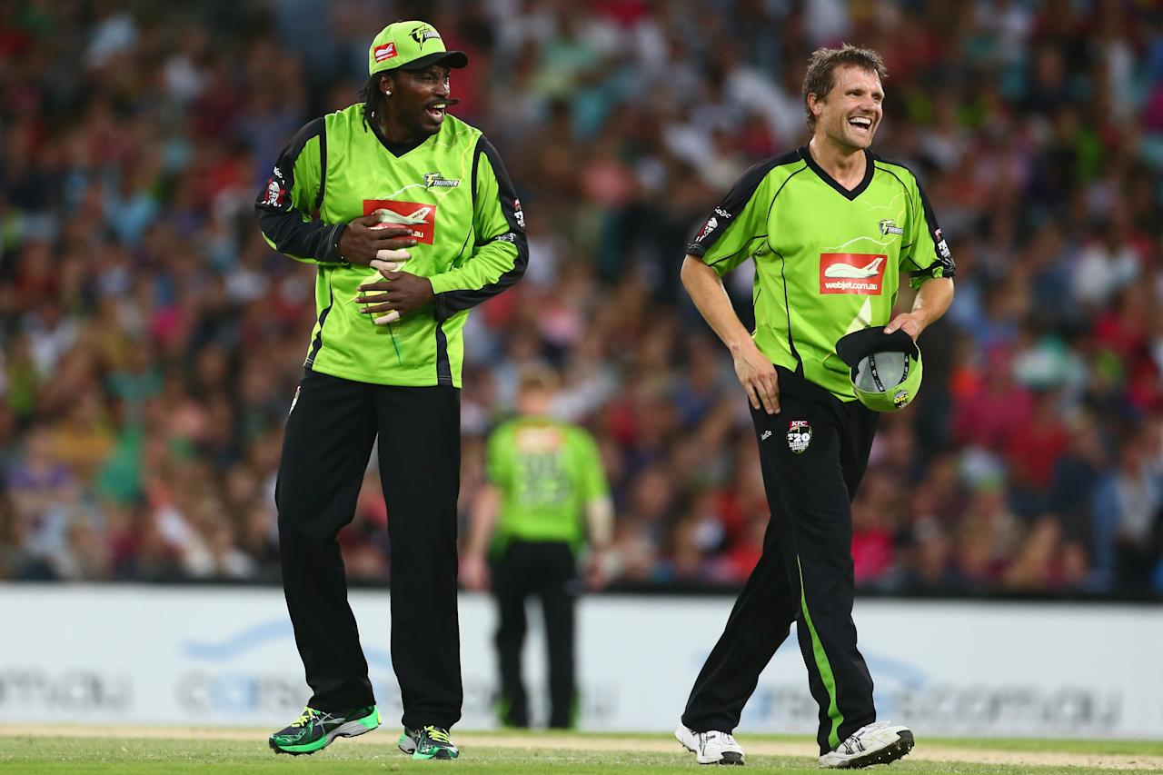 SYDNEY, AUSTRALIA - DECEMBER 30:  Chris Gayle and Dirk Nannes of the Thunder share a laugh after combining to remove Nic Maddinson of the Sixers share a laugh during the Big Bash League match between Sydney Thunder and the Sydney Sixers at ANZ Stadium on December 30, 2012 in Sydney, Australia.  (Photo by Mark Kolbe/Getty Images)
