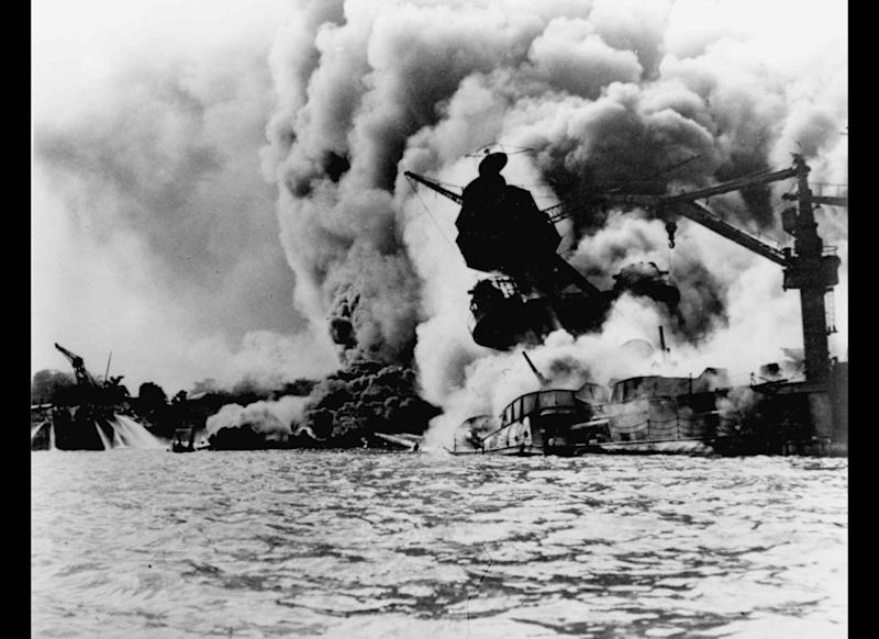 The USS Arizona is pictured in flames after the Japanese attack.