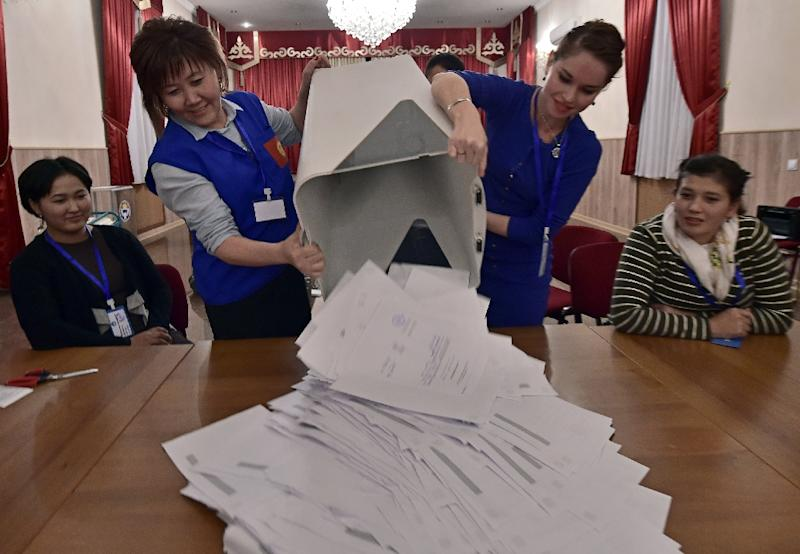 Members of a local election committee empty a ballot box. Some have said the timing of the reburial -- on the eve of an October 15 presidential election -- indicates the influence of superstitions that have gripped the country's politics in the past (AFP Photo/Vyacheslav OSELEDKO)