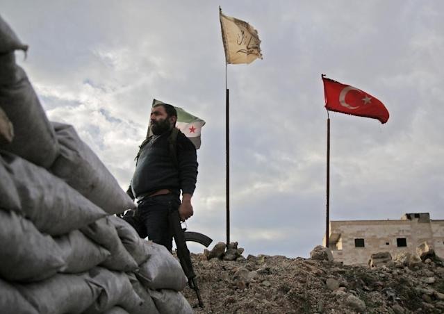 Critics have accused Turkish troops and their proxies of the military occupation of Syrian sovereign territory (AFP Photo/Bakr ALKASEM)