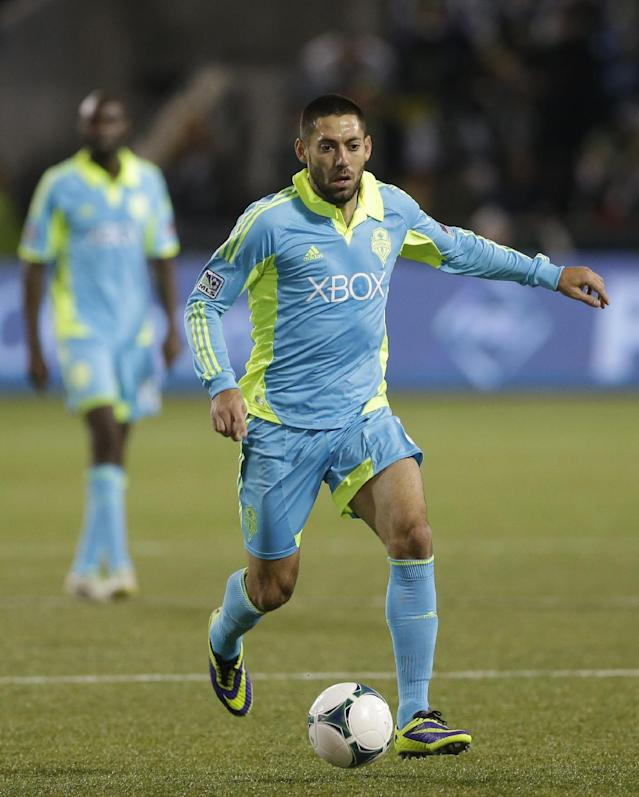 Seattle Sounders' Clint Dempsey dribbles the ball against the Portland Timbers in the first half of the second game of the Western Conference semifinals in the MLS Cup soccer playoffs, Thursday, Nov. 7, 2013, in Portland, Ore. (AP Photo/Ted S. Warren)
