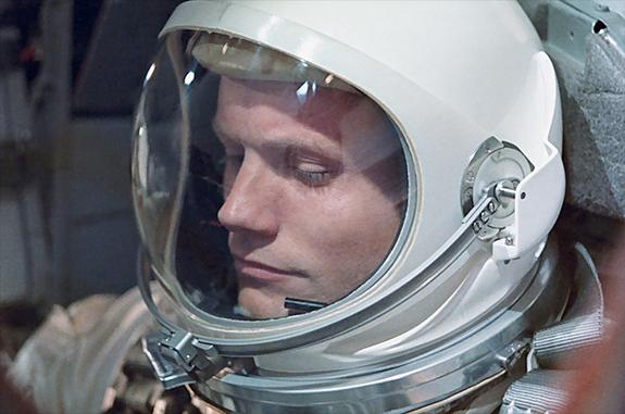 Neil Armstrong, seen here aboard Gemini 8, was the first U.S. civilian to fly into orbit. Armstrong had retired from the U.S. Navy in 1960. This photo was relatively rarely-seen until it was used as the cover of Armstrong's authorized biography