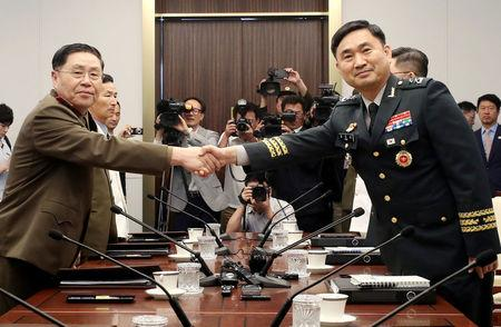 North Korean Lieutenant General An Ik San shakes hands with South Korean Major General Kim Do-gyun during a meeting at the Peace House of the border village of Panmunjom, South Korea, July 31, 2018.    Yonhap via REUTERS   ATTENTION EDITORS - THIS IMAGE HAS BEEN SUPPLIED BY A THIRD PARTY. SOUTH KOREA OUT. NO RESALES. NO ARCHIVES.