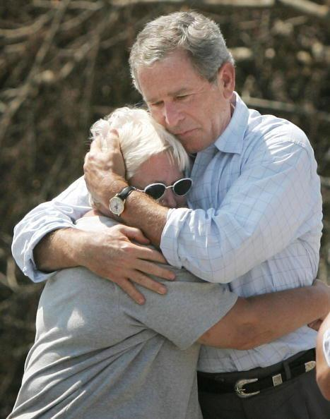 After Hurricane Katrina, former President George W. Bush hugged a hurricane victim whose home was destroyed in Biloxi, Mississippi. (Win McNamee via Getty Images)