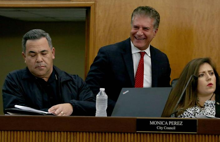 Hialeah Mayor Carlos Hernández walks by City Councilwoman Monica Perez and Police Chief Sergio Velázquez, during a City Council meeting on Tuesday, Jan. 28, 2020.