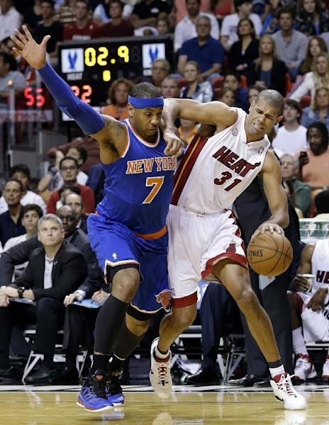 Miami Heat forward Shane Battier (31) is fouled by New York Knicks forward Carmelo Anthony (7) during the first half of an NBA basketball game, Tuesday, April 2, 2013 in Miami. (AP Photo/Wilfredo Lee)