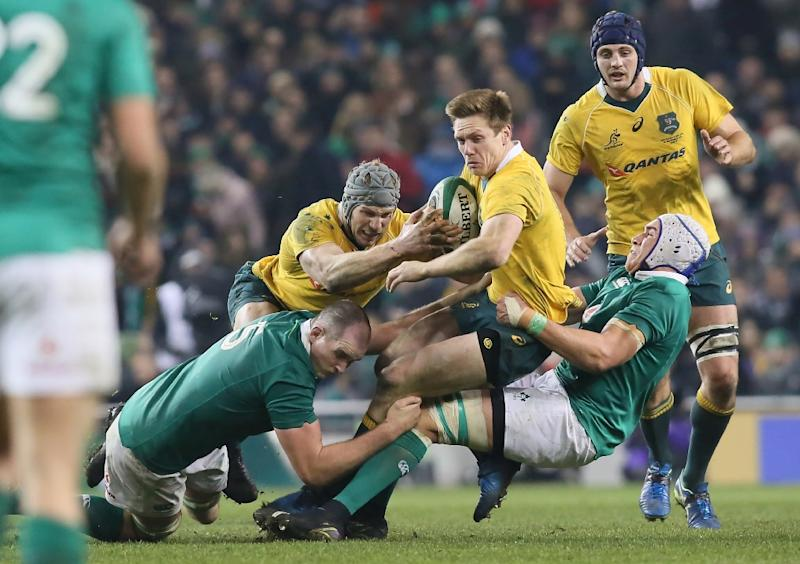 Australia's Reece Hodge is tackled during the match against Ireland in Dublin on November 26, 2016 (AFP Photo/Paul Faith)