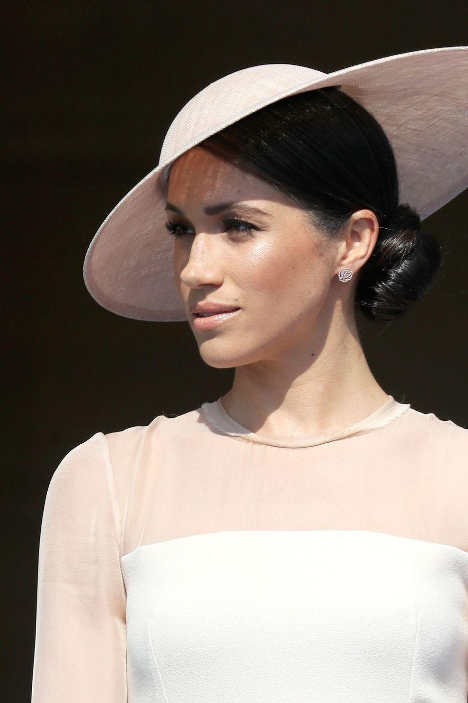 """<p>The <a href=""""https://www.goodhousekeeping.com/life/a19662278/meghan-markle-title/"""" rel=""""nofollow noopener"""" target=""""_blank"""" data-ylk=""""slk:Duchess of Sussex"""" class=""""link rapid-noclick-resp"""">Duchess of Sussex</a> likes to rep <a href=""""https://www.goodhousekeeping.com/beauty/news/a47608/meghan-markle-messy-bun/"""" rel=""""nofollow noopener"""" target=""""_blank"""" data-ylk=""""slk:loose buns"""" class=""""link rapid-noclick-resp"""">loose buns</a>, but her tighter chignons look super sleek thanks to this quick tip. """"For my flyaways, I spray hairspray on a small boar bristle toothbrush (a regular toothbrush also works great!) to lightly brush them down or smooth the hairline,"""" she told <a href=""""https://www.birchbox.com/magazine/article/meghan-markle-suits-beauty-secrets?"""" rel=""""nofollow noopener"""" target=""""_blank"""" data-ylk=""""slk:Birchbox"""" class=""""link rapid-noclick-resp"""">Birchbox</a>. """"This is especially good for a sleek bun when I am off-camera.""""</p>"""