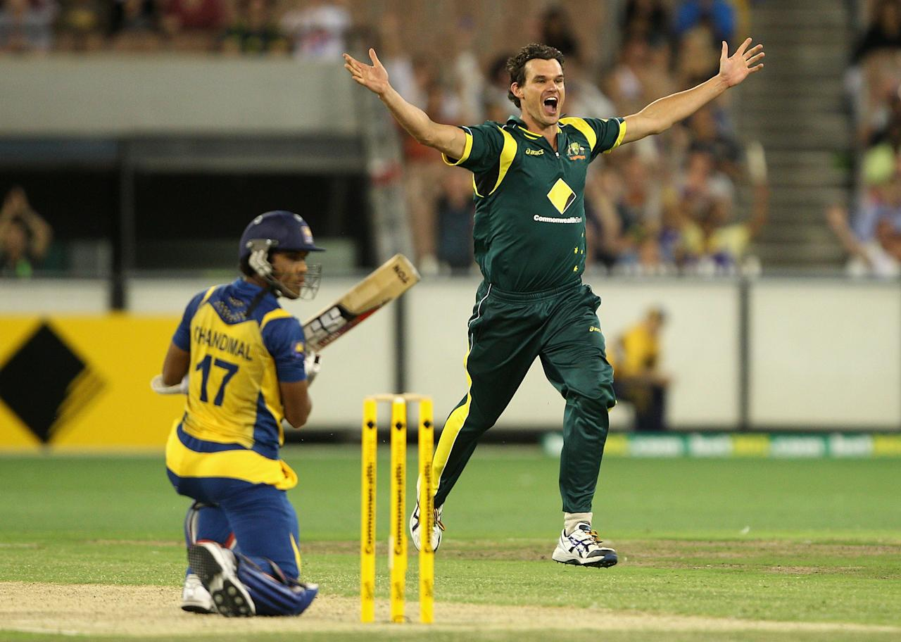 MELBOURNE, AUSTRALIA - JANUARY 11:  Clint McKay of Australia celebrates the wicket of Dinesh Chandimal of Sri Lanka during game one of the Commonwealth Bank One Day International series between Australia and Sri Lanka at Melbourne Cricket Ground on January 11, 2013 in Melbourne, Australia.  (Photo by Robert Prezioso/Getty Images)
