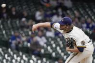 Milwaukee Brewers starting pitcher Corbin Burnes throws during the first inning of a baseball game against the Chicago Cubs Wednesday, April 14, 2021, in Milwaukee. (AP Photo/Morry Gash)