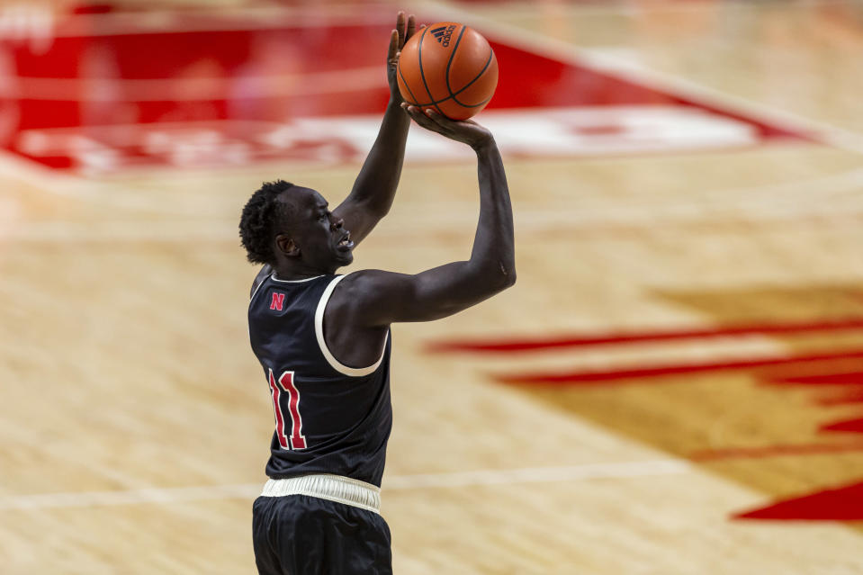 Nebraska forward Lat Mayen (11) makes a three-point basket against Rutgers in the first half during an NCAA college basketball game Monday, March 1, 2021, in Lincoln, Neb. (AP Photo/John Peterson)