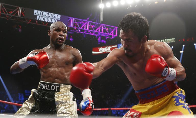 Floyd Mayweather exchanges punches with Manny Pacquiao during their welterweight unification championship bout on May 2, 2015 at MGM Grand Garden Arena