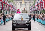 <p>Waving to crowds from the Mall to mark the Queen's 90th birthday celebrations.</p>