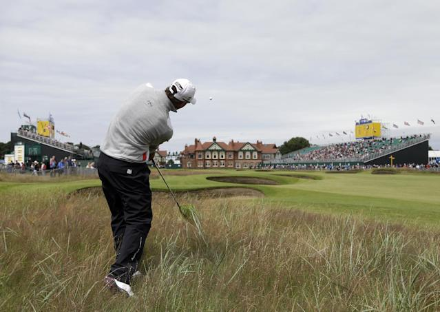 Adam Scott of Australia plays out of rough to the 18th green at Royal Lytham & St Annes golf club during the first round of the British Open Golf Championship, Lytham St Annes, England, Thursday, July 19, 2012. (AP Photo/Chris Carlson)
