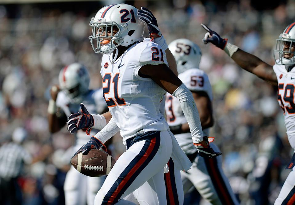 Virginia's Juan Thornhill (21) celebrates his interception against Connecticut in the second half of an NCAA college football game at Pratt & Whitney Stadium at Rentschler Field, Saturday, Sept. 17, 2016, in East Hartford, Conn. (AP Photo/Jessica Hill)