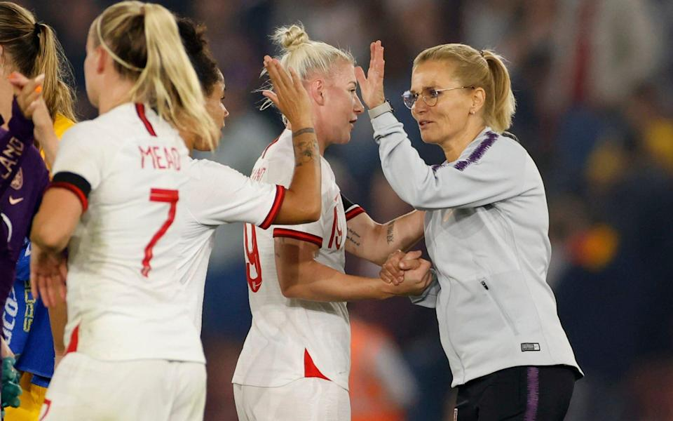 New coach Sarina Wiegman celebrates the win with her players - ACTION IMAGES