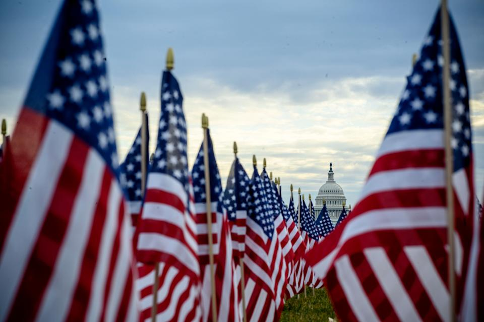 The flag display, organized by the Presidential Inaugural Committee, makes up part of the event's theme of unity. (Photo: ERIC BARADAT via Getty Images)