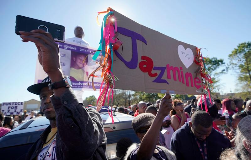People attend a community rally outside a Walmart on East Sam Houston Pkwy North in Houston on Jan. 5, 2019.