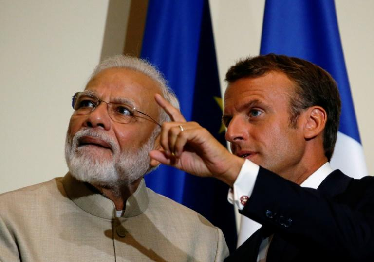 France will be keeping an eye on rights issues in divided Kashmir, President Emmanuel Macron told India's Narendra Modi