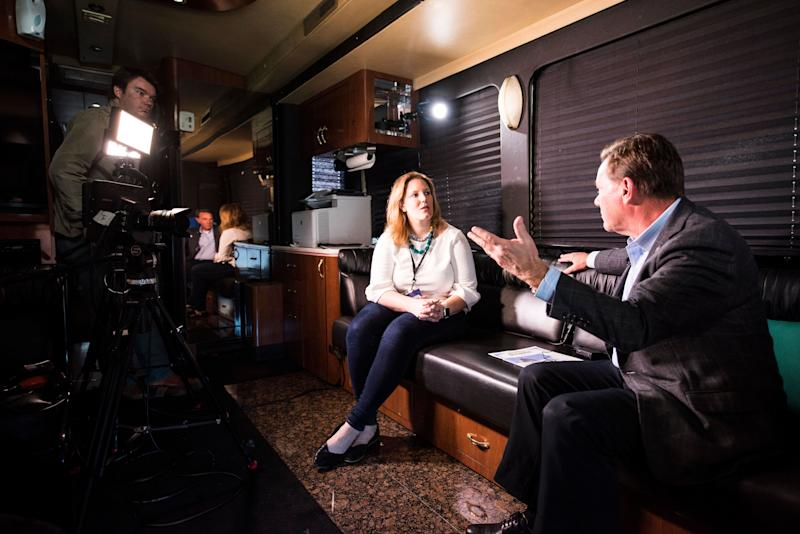 Kate Palmer interviews Eskridge on the bus.