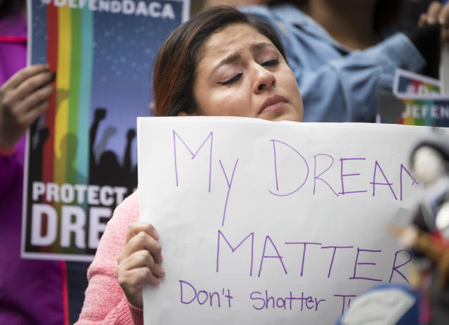 "<p>Evelin Hernandez cries as she hold a sign reading ""My dreams matter. Don't shatter them."" at a protest against the announcement that the Trump administration is ending the Deferred Action for Childhood Arrivals program, known as DACA, in Minneapolis, Minn., Tuesday, Sept. 5, 2017. Hernandez is a special education paraprofessional and a DREAM act recipient. (Photo: Renee Jones Schneider/Star Tribune via AP) </p>"