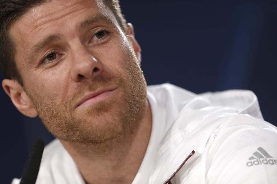 FILE - In this April 17, 2017 file photo, Bayern Munich's Xabi Alonso listens to a question during a news conference at the Santiago Bernabeu stadium in Madrid, Spain. German media reports say that former Spain midfielder Xabi Alonso is to take over at Borussia Moenchengladbach coach next season. The tabloid Bild and its sister magazine Sport Bild first reported that the 39-year-old Alonso has agreed to take over from current Gladbach coach Marco Rose, who is joining Borussia Dortmund next season. (AP Photo/Francisco Seco, File)