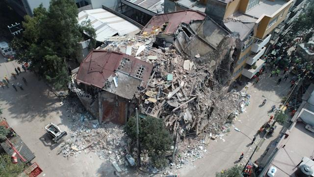 <p>Aerial view of a flattened building in Mexico City taken on Sept. 20, 2017 as the search for survivors continues a day after a strong quake hit central Mexico.<br> (Photo: Mario Vazquez/AFP/Getty Images) </p>