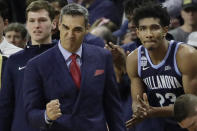 FILE - Villanova head coach Jay Wright and forward Jermaine Samuels (23) celebrate from the bench in the last seconds of an NCAA college basketball game against Providence in Providence, R.I., in this Saturday, Jan. 25, 2020, file photo. Villanova won, 64-60. Villanova will begin the college basketball season at No. 3 in the preseason AP Top 25 poll released Monday, Nov. 9, 2020.(AP Photo/Elise Amendola, File)