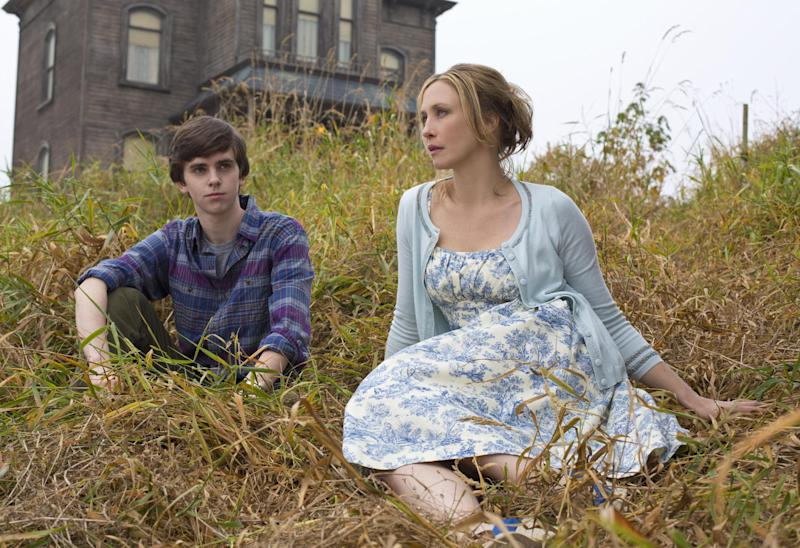 """This undated publicity image released by A&E shows Freddie Highmore as Norman Bates, left, and Vera Farmiga as Norma Bates in a scene from A&E's """"Bates Motel,"""" premiering Monday, March 18, 2013 at 10 p.m. on A&E. (AP Photo/A&E, Joe Lederer)"""