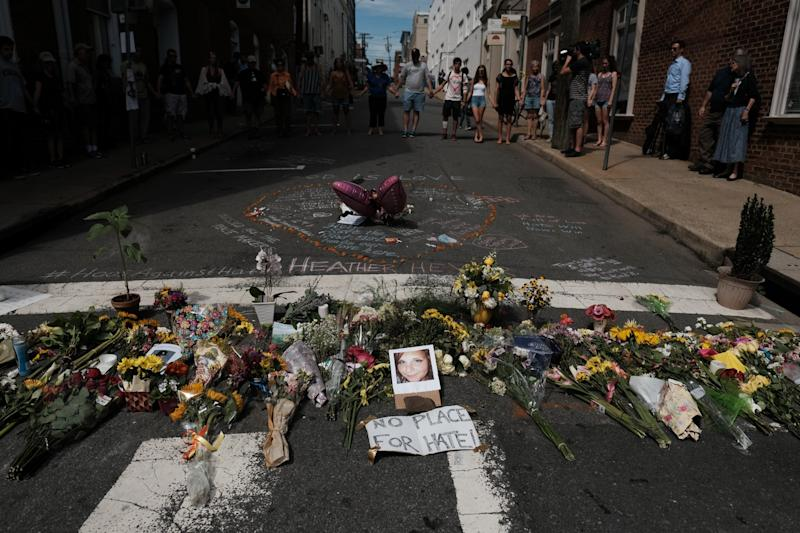 Flowers and a photo of car ramming victim Heather Heyer lie at a makeshift memoriall in Charlottesville, Virginia, August 13, 2017.