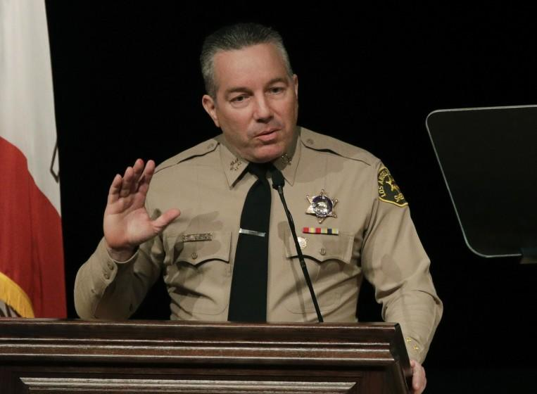 FILE - In this Dec. 3, 2018 file photo newly-elected Los Angeles County Sheriff Alex Villanueva speaks during a swearing-in ceremony in Monterey Park, Calif. Villanueva will limit when inmates in the county's jails can be transferred to federal authorities for deportation. Sheriff's Department spokeswoman Nicole Nishida said on Friday, Feb. 15, 2019, the agency will reduce the number of misdemeanor charges that can trigger an inmate's transfer. She could not immediately say which misdemeanor charges would no longer qualify. (AP Photo/Jae C. Hong, File)