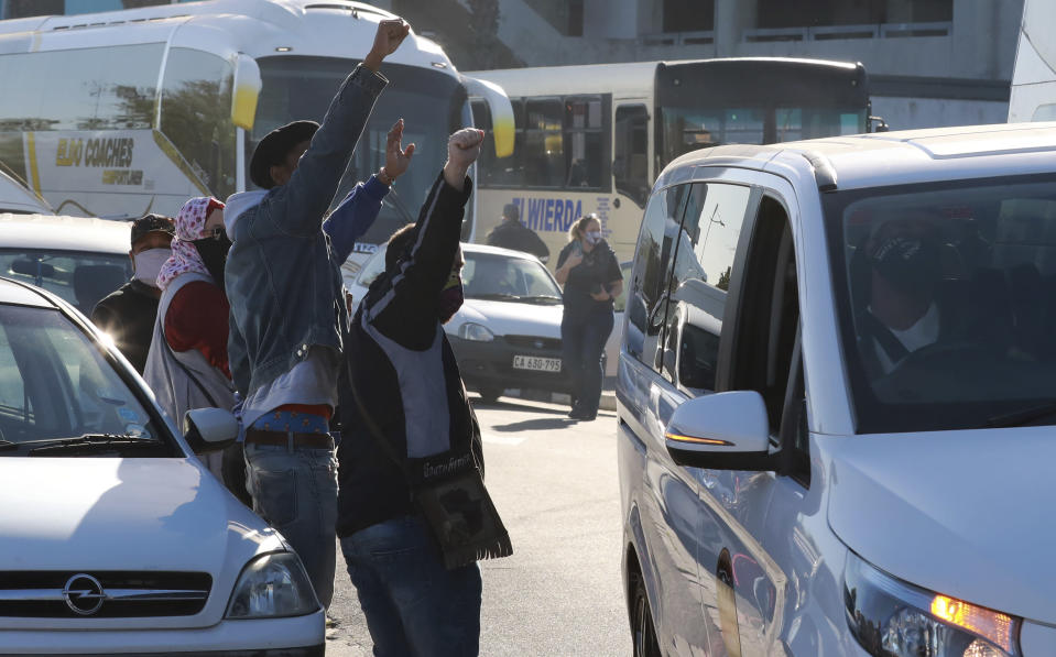 Tour operators take part in a protest in Cape Town, South Africa, Friday July 31, 2020. Various tourism operators staged a slow drive protest as they struggle to make ends meet under the COVID-19 lockdown regulations. (Photo/Nardus Engelbrecht)