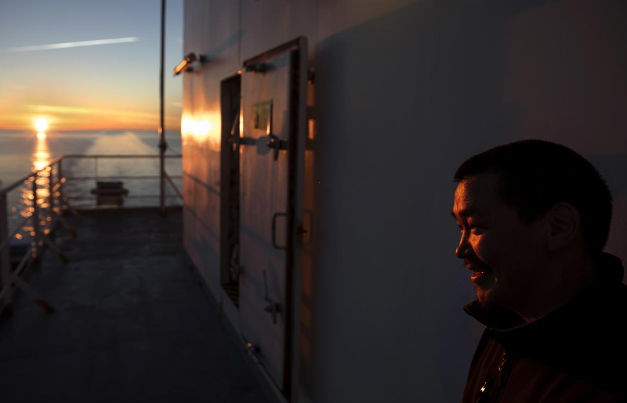 "Trainee Maatiusi Manning stands aboard the Finnish icebreaker MSV Nordica as it traverses the Northwest Passage in the Canadian Arctic Archipelago, Thursday, July 27, 2017. ""Cruise ships coming in and out more and more, it is affecting our ice,"" said Manning, an Inuk from Baffin Island's Cape Dorset. ""It basically opens up so much ice that we can't even use the ice anymore, and we have to go by land where it was just right across before."" The 33-year-old is now training to work aboard a factory fishing ship, part of a drive to create more economic opportunities for the Inuit. (AP Photo/David Goldman)"