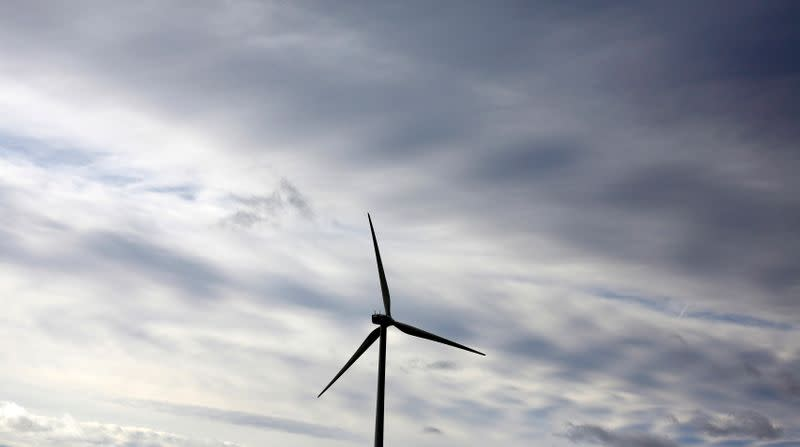 An Iberdrola's power generating wind turbine is seen against cloudy sky at Moranchon wind farm